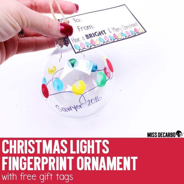A cute and easy Christmas Light Fingerprint Ornament for your students to give as gifts! Click the image to grab the free Christmas gift tags in the blog post. This easy Christmas craft project will be a keepsake gift families treasure year after year! By Miss DeCarbo