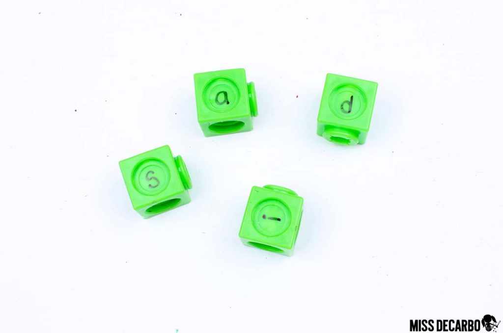 Build words with cubes - 20 Word Work Ideas for Sight Word Spelling Practice (with freebies!)